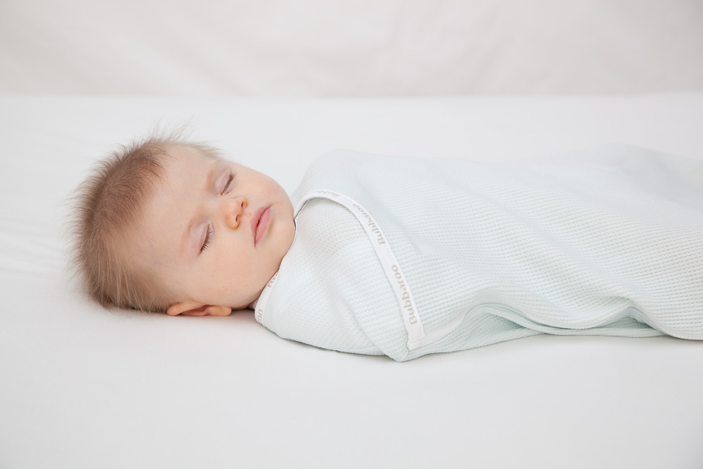 Baby asleep in Bubbaroo Joey Pouch Swaddle Wrap